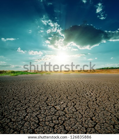 drought land and dramatic sunset