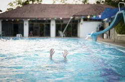 drowning child or kid and people cannot swim to deep water and raise two hands for help on swimming pool and near death with dark vignetting