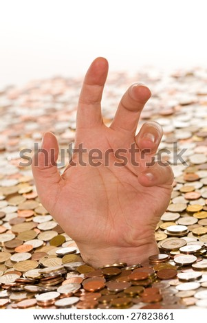Drowning in debt concept, man hand reaching up from below a layer of coins