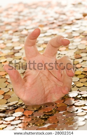 Drowning in debt concept - man hand trying to get a grasp, covered in coins