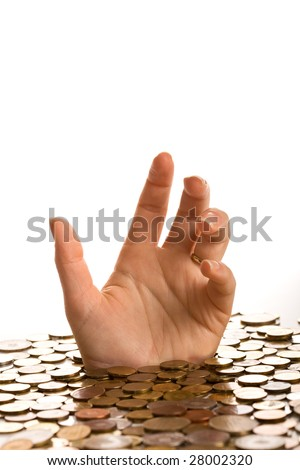Drowning in debt concept - woman hands reaching up from below coins