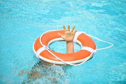 Drowning kid. Helping lifebuoy with hands in the water. Life buoy survive. Support survival or save, Concept of help, rescue