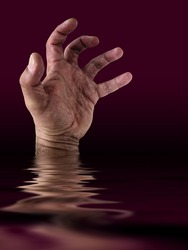 Drowning man's hand  in the ocean.