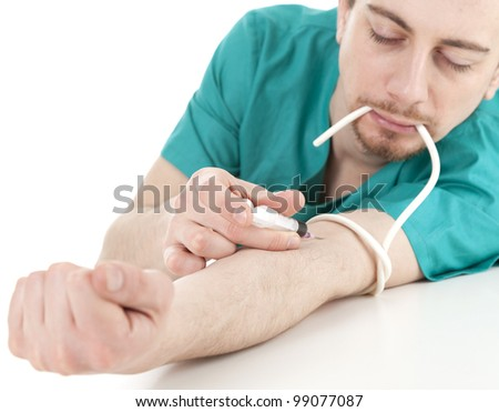 drug addict medical doctor man with syringe in action, white background