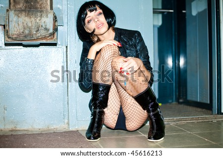 stock photo : drug addict prostitute young woman with heroin syringe