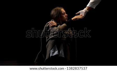 Drug addicted female taking doctors hand in protective glove, hope in future #1382837537