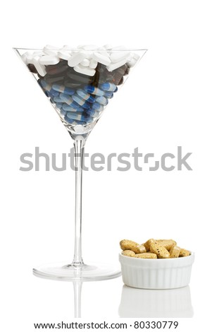 Drug cocktail with some pill snack on the side - medication overdose or abuse concept