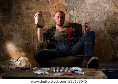 Shutterstock Drug dealer drinks alcohol and selling different types of narcotics. Drugs selling concept. Image of drug mafia, cartels, dealers.