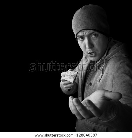 drug dealer selling heroin or cocaine and asking for money black and white with copy space
