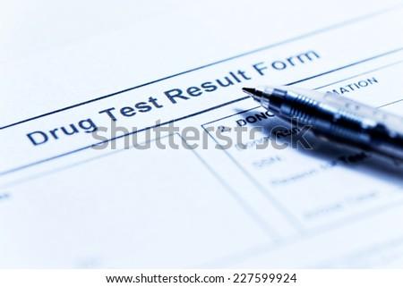 Drug test blank form with pen
