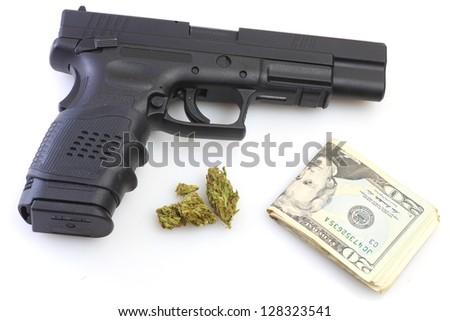 Drug Trade Wealth/Handgun, marijuana buds & US currency against white background