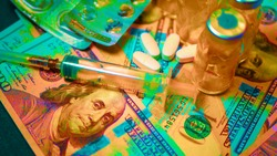 Drug trip. Drugs in ampoules and money in rainbow colors. Us 100$ bills and Russian currency (1000 rubles). The concept of buying and selling drugs and drug addiction. Template.