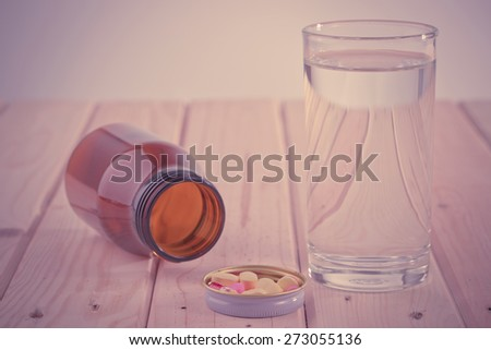 Drugs and drinking water on a white background.Vintage #273055136
