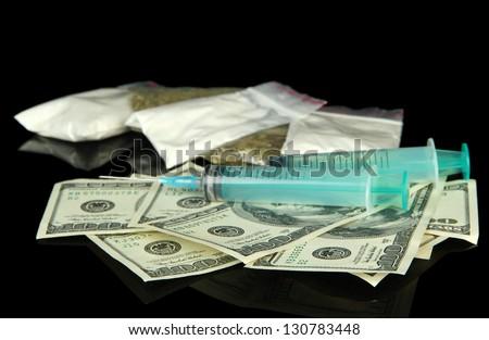 Drugs, money and  syringes, isolated on black - stock photo