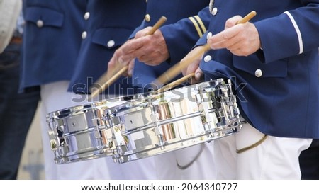 Drum players of a marching band with blue uniforms