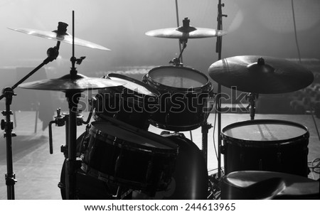 drum set on stage in a concert hall