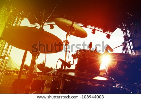 Drum set on stage, silhouette