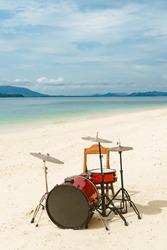 Drum set on the tropical beach.