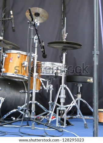 drum set with microphones on a stage ready for a concert