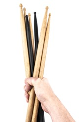 Drum sticks in hand isolated on white background