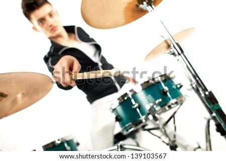 Drummer holding his drum stick in focus near drum set