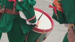 Drummer In Traditional Costume Playing on Drum during Street Festival Celebration