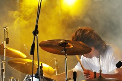 drummer play on concert in puff of smoke