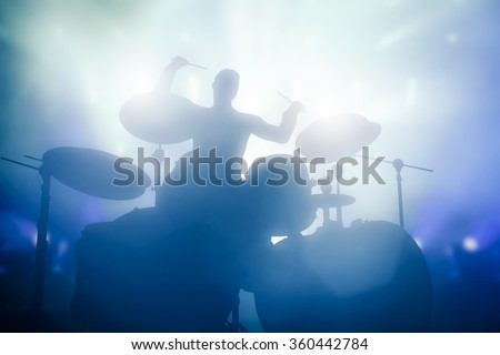 Drummer playing on drums on music concert. Club lights, artist show. #360442784