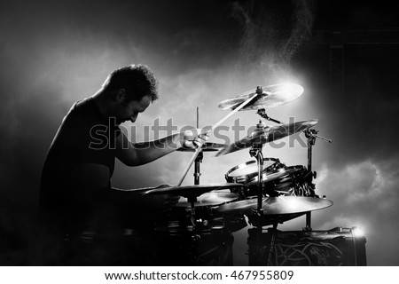 Drummer playing the drums with smoke and powder in the background #467955809