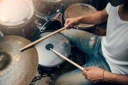 Drummer plays drum in studio