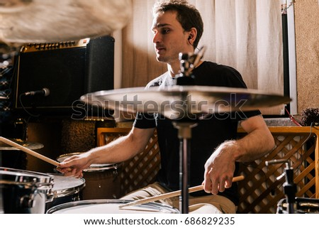 Drummer rehearsing on drums before rock concert. Man recording music on drum set in studio #686829235