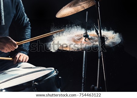 Drummer rehearsing on drums before rock concert. Man recording music on drum set in studio #754463122