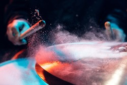 Drummer's rehearsing on drums before rock concert. Man recording music on drumset in studio