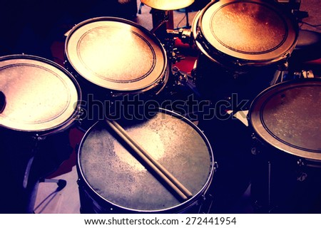Drums conceptual image Picture of drums and drumsticks lying on snare drum Retro vintage picture