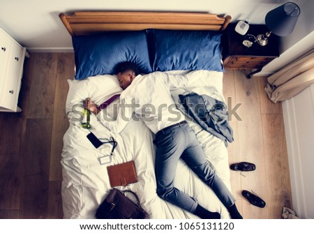Drunk African American business man falling asleep as soon as he came back home