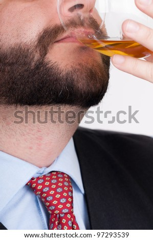 Drunk businessmen drinking from a bottle of whiskey
