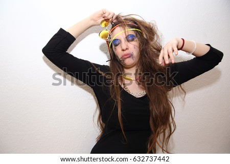 Drunk girl with smeared makeup posing at party  #632737442