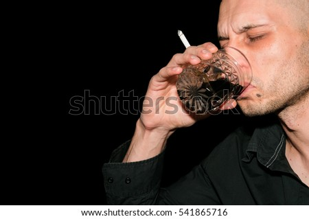 Drunk man drinking alcohol and smoke cigarette. #541865716