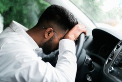 Drunk man slumped on steering wheel in his car