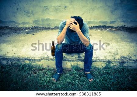 Drunk man with bottle,Sad,Despair,Depressed,Vintage sepia #538311865