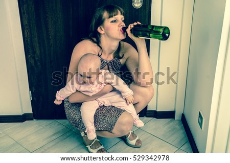 Drunk reckless woman drinking alcohol and holding her baby after return from night party - retro style #529342978