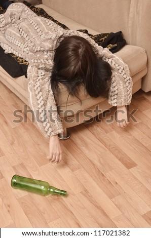 drunk woman sleeping on the sofa