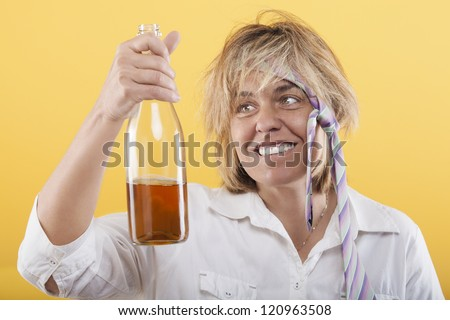Drunk woman with bottle, badly dressed, with cheerful expression