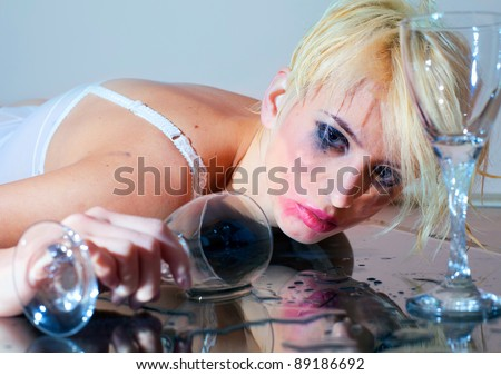 Drunk young woman with drinking glass
