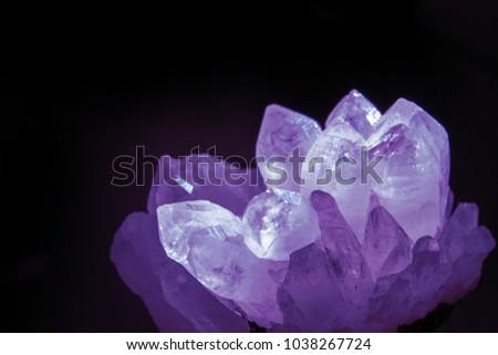 Druze of quartz crystals on black background.  #1038267724