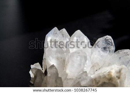 Druze of quartz crystals on black background.  #1038267745