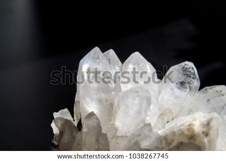 Druze of quartz crystals on black background.  #1038267745