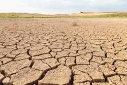 Dry and cracked land, dry due to lack of rain, in the Loteta reservoir, near the town of Gallur, Spain. Effects of climate change such as desertification and droughts.