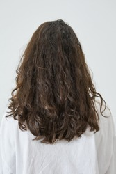 Dry and frizzy natural curly hair that needs hydration. Natural curls before salon treatment. close up, soft focus