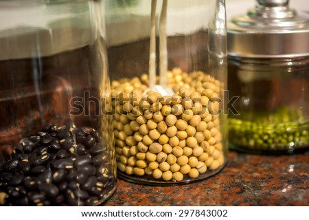 Dry beans stored in glass canisters in the kitchen